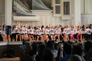 Students flood the stage for the opening number, dressed in this year's Dancefest tee!